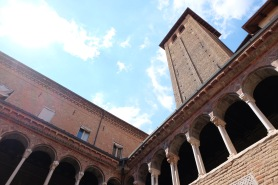 A courtyard and tower in the Basilica de Santo Stefano